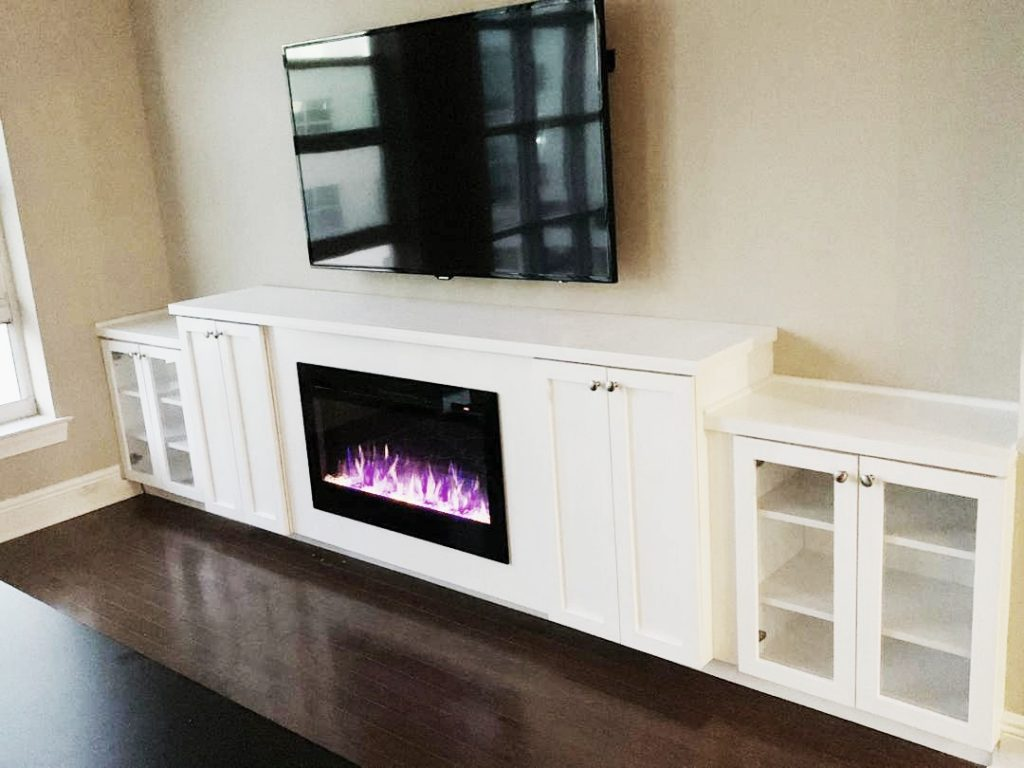 custom built cabinet with fireplace